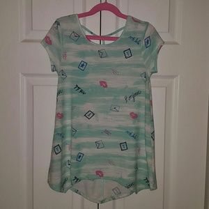 Very cute girls top with strappy back size 7/8.